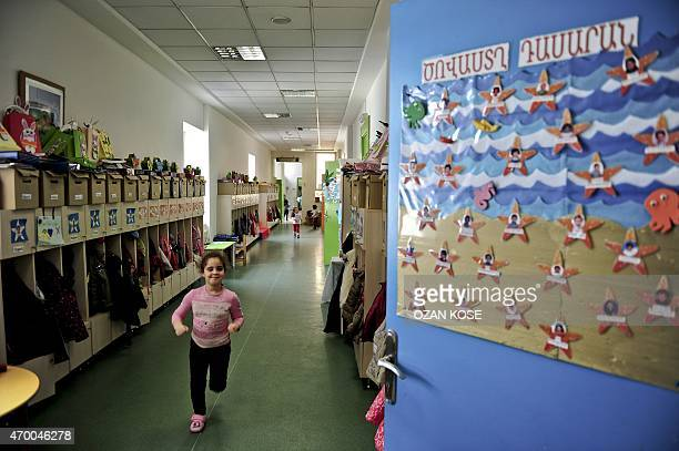 A young pupil runs through a corridor at the Karagozyan Armenian primary school in Istanbul on March 27 2015 Yasmin Rostomyan one of around 60000...