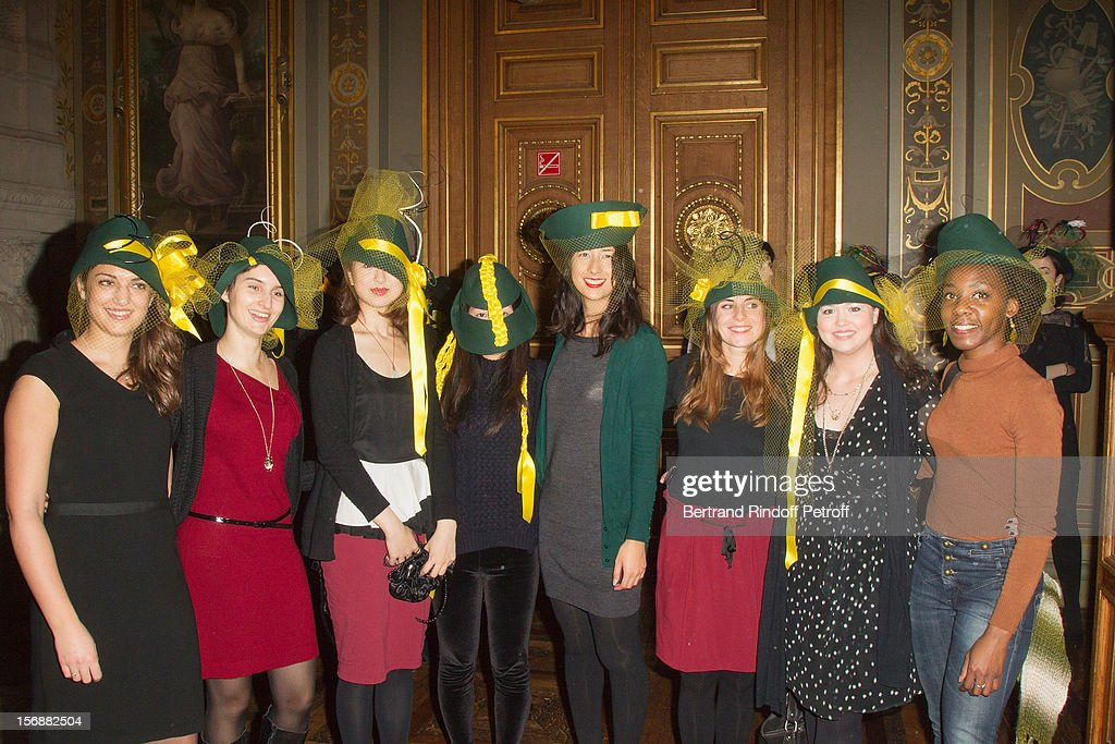 Young pupils of the Federation Francaise de la Couture Fashion School (French Federation of Couture School) pose at the Paris City Hall during the Sainte-Catherine Celebration on November 23, 2012 in Paris, France.
