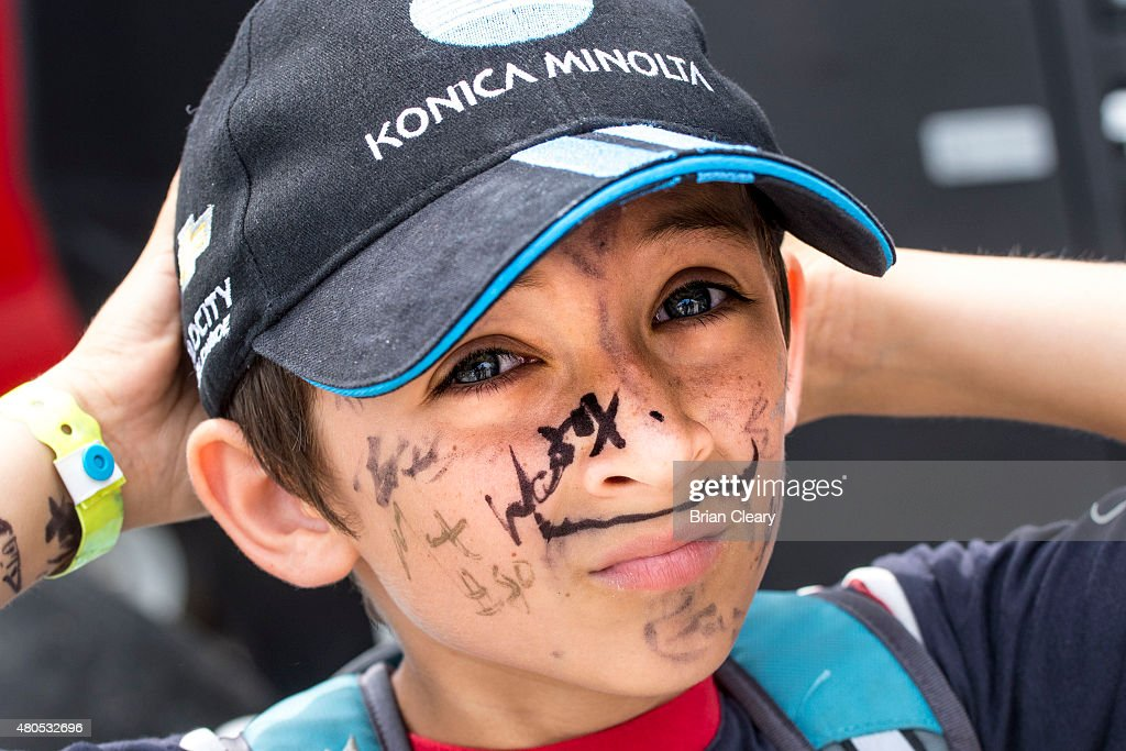 Young race fan Nicholas Swaluk shows off driver autographs on his face in the paddock before the IMSA Tudor Mobil 1 Grand Prix at Canadian Tire...