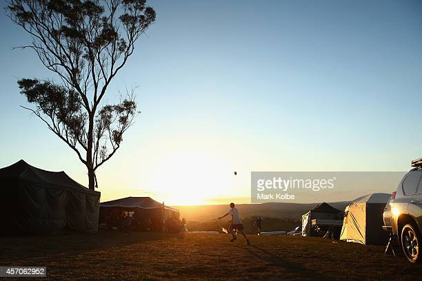 Young race fans play football in the campground at the end of racing during the V8 Supercars Bathurst 1000 weekend at Mount Panorama on October 11...