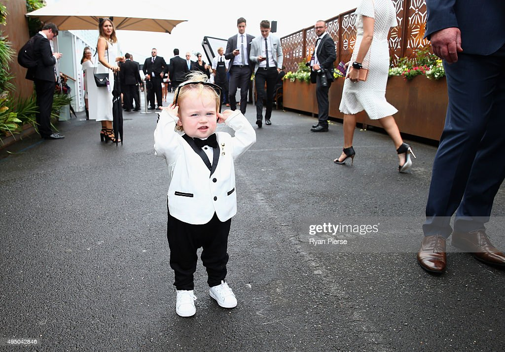 A young racegoer looks on on Victoria Derby Day at Flemington Racecourse on October 31 2015 in Melbourne Australia