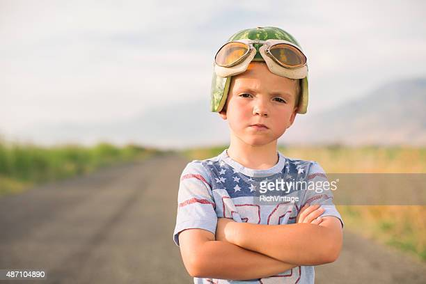 Young Racing Boy in Watermelon Helmet