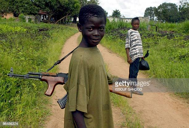 Young rebels fighters from the Liberians United for Reconciliation and Democracy patrol 15 September 2002 in Voinjama Until recently a shadowy rebel...