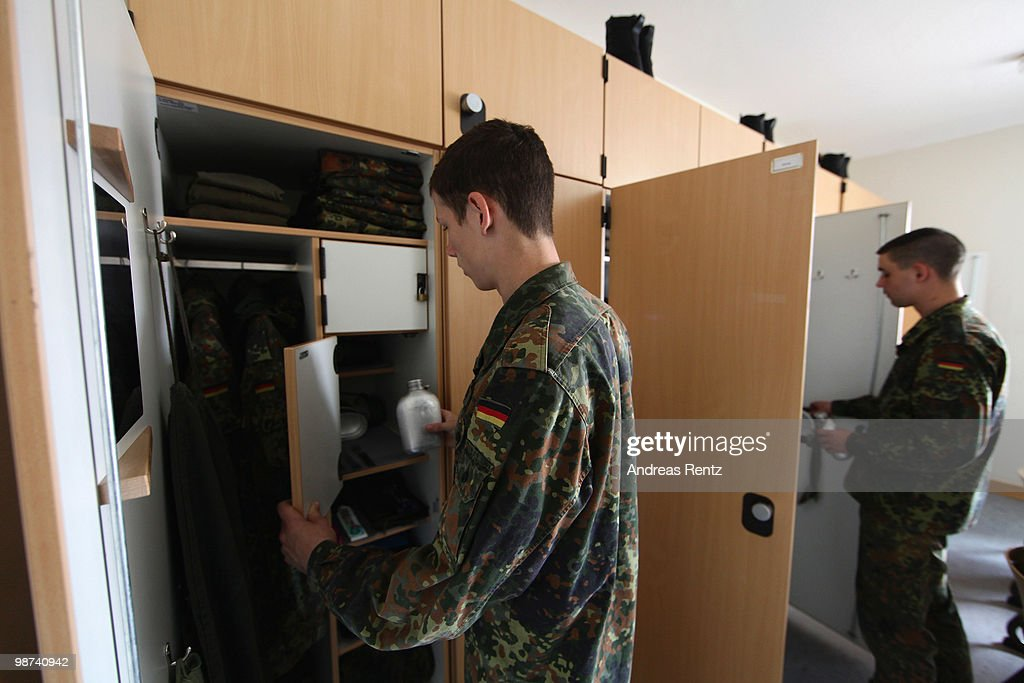Young recruits of the German Bundeswehr get dressed in their living room during their nine months military service at the Julius Leber barracks on...