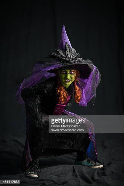 Young redheaded girl dressed as witch at Halloween