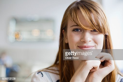 Young redheaded woman in cafe : Stock Photo