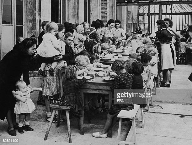 Young refugees from Dunkirk are fed by the Canadian forces during World War II circa 1940