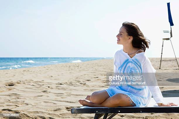 Young relaxed woman at beach