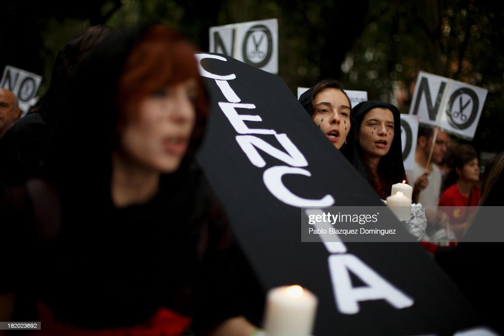 Young researchers carry a cardboard cut out of a coffin reading 'Science' during a demonstration against R&D cuts for sciences on September 27, 2013 in Madrid, Spain. Young Spanish scientists have called for a demonstration during the European Researchers' Night under the header, 'No Sciences, No Future', in response to cutbacks in research and development for Sciences. They claim that many Spanish researchers are leaving the country to find a jobs.