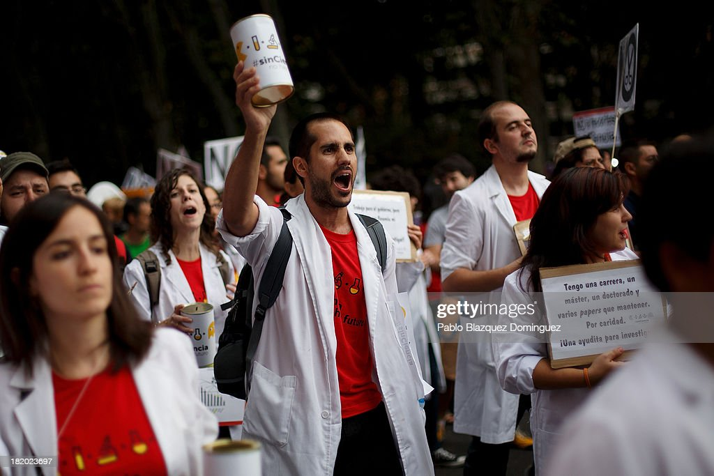 Young researchers shout slogans during a demonstration against R&D cuts for sciences on September 27, 2013 in Madrid, Spain. Young Spanish scientists have called for a demonstration during the European Researchers' Night under the header, 'No Sciences, No Future', in response to cutbacks in research and development for Sciences. They claim that many Spanish researchers are leaving the country to find a jobs.