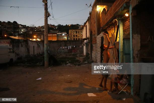A young resident plays in the MetroMangueira 'favela' commmunity on July 26 2017 in Rio de Janeiro Brazil Most of the favela remains abandoned...