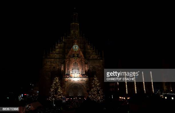 Young resident Rebecca Ammon dressed as the 'Nuremberg Christkind' stands at the balcony of the Frauenkirche Church during the opening of the...