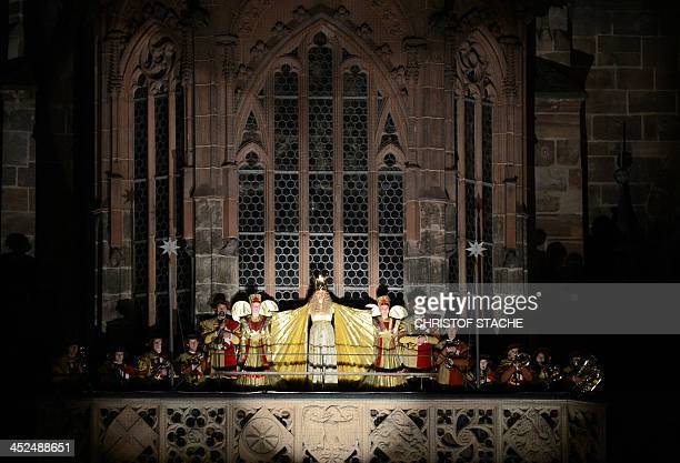 Young resident Theresa Treuheit dressed as the 'Nuremberg Christ Child' stands at the balcony of the Frauenkirche Church during the opening of the...