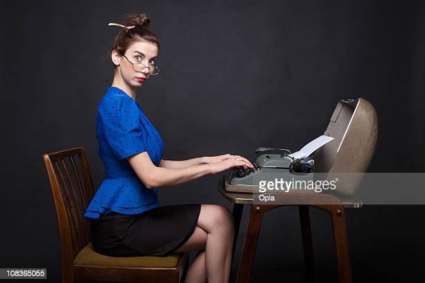 Young retro secretary typing
