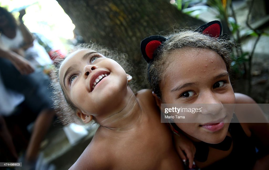 Young revelers celebrate at a 'bloco' street party during pre-Carnival festivities on February 23, 2014 in Rio de Janeiro, Brazil. Carnival officially begins on February 28 but pre-festivities have already begun. Brazil is gearing up to host the 2014 FIFA World Cup.
