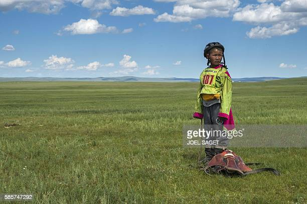 A young rider looks on after a horse race during the traditionnal Nadaam festival in a nomad camp in the Ovorkhangai province on July 19 2016 / AFP /...