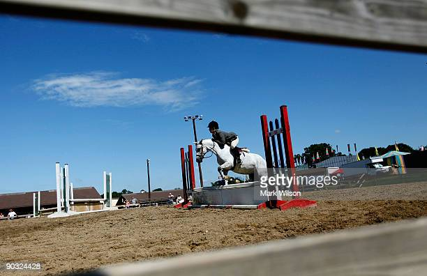 A young rider performs a jump during a equestrian event at the Maryland State Fair September 3 2009 in Timonium Maryland Due to the current economic...