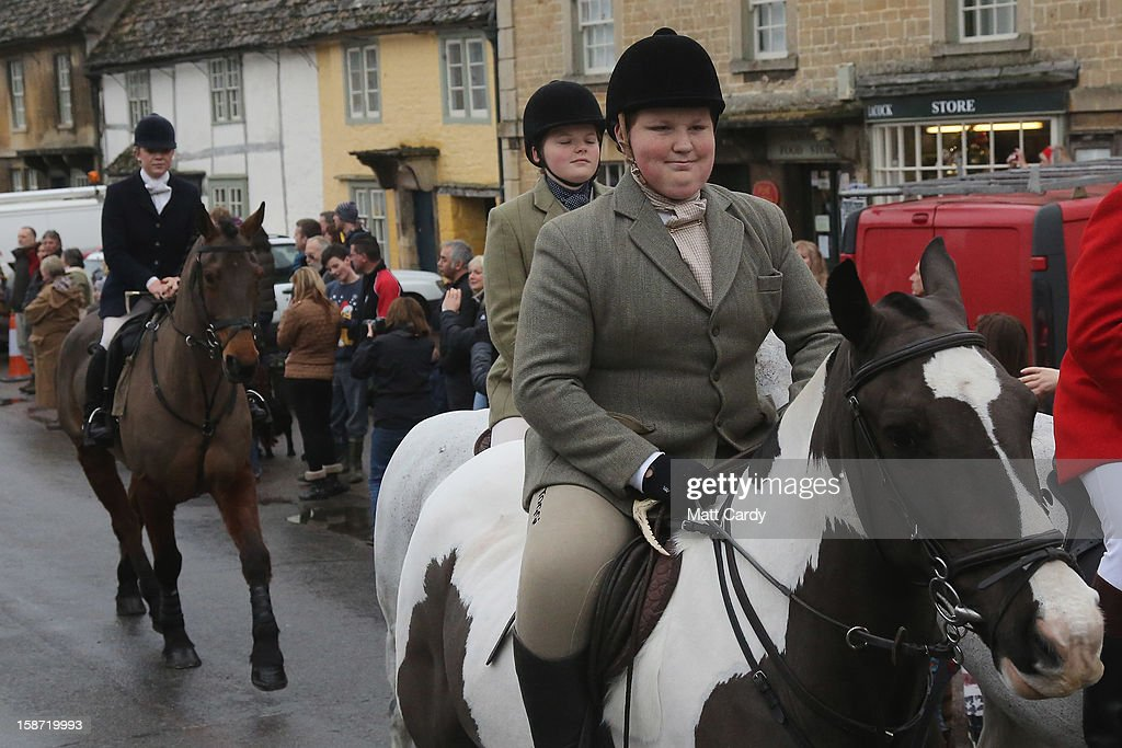 A young rider with the Avon Vale Hunt, follows the hounds as they ride out for their traditional Boxing Day hunt, on December 26, 2012 in Lacock, England. As hundreds of hunts met today, Environment Secretary Owen Paterson claimed that moves to repeal the ban on hunting with dogs in England and Wales may not happen in 2013, although he insisted it was still the government's intention to give MPs a free vote on lifting the ban.