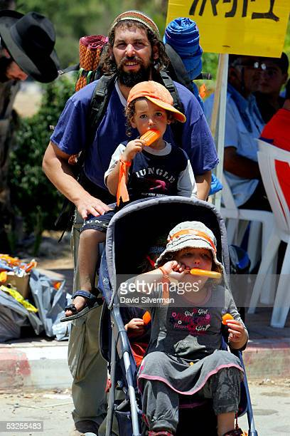 Young rightwing settler children eat orange ice lollies made especially in the color of the antidisengagement movement as thousands gather for a mass...