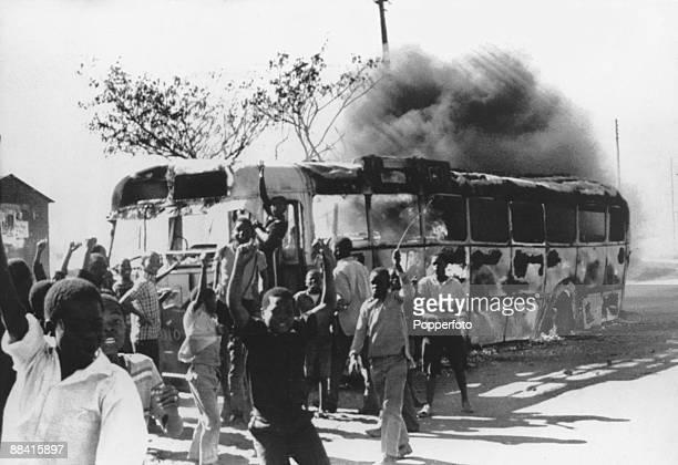 Young rioters surround a burning bus during the Soweto Uprising in Johannesburg 17th June 1976 The riots were a reaction against the government's...