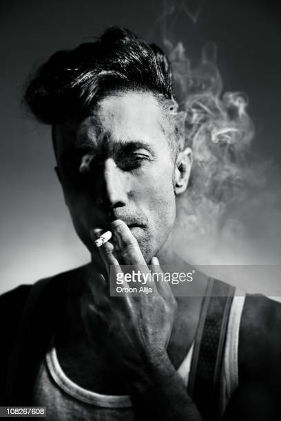Young Rockabilly Man Smoking Cigarette, Black and White