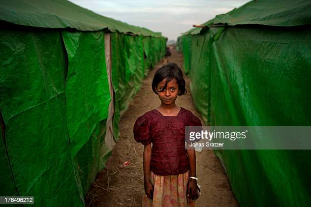 A young Rohingya girl stands in the alley between the tents in the IDP refugee camps of Sittwe Sittwe now has over 125000 people who are isolated...