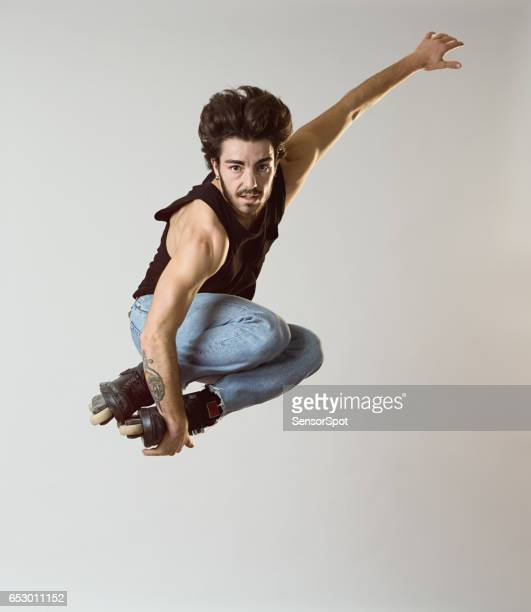 Young roller blade skater jumping
