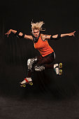 Young roller derby woman jumping