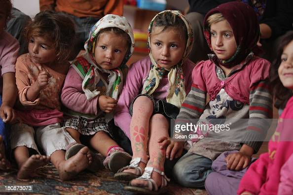 Young Roma children attend a preschool class in the abjectly poor Roma settlement of Ponorata on September 11 2013 in Ponorata Romania A Romanian NGO...