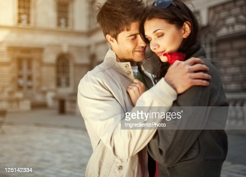 Young romantic couple embracing and smiling : Stock Photo