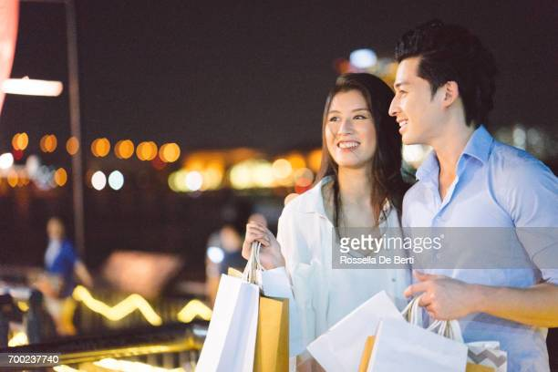 Young romantic couple enjoing city waterfront at night