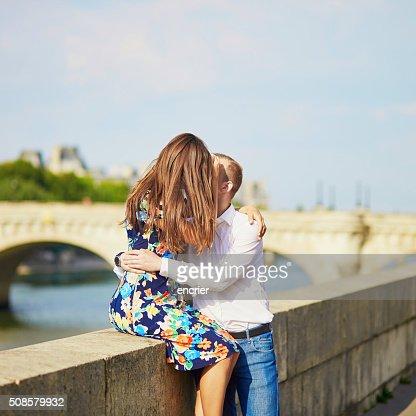 Young romantic couple on the Seine embankment : Stock Photo