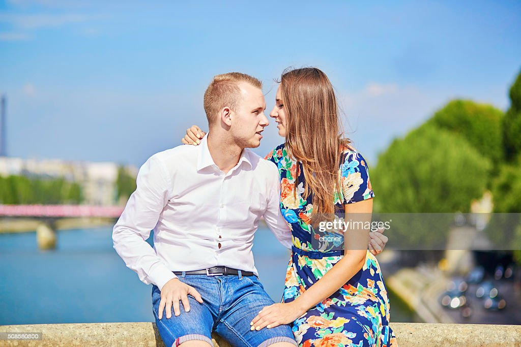 Young romantic couple on the Seine embankment : Stock Photo