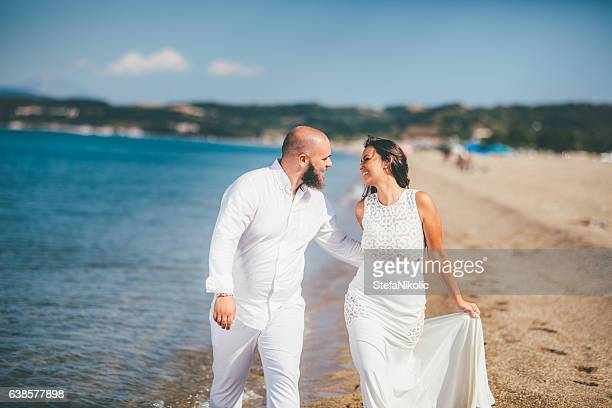 Young Romantic Couple Playing on the Beach