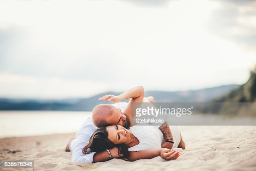 Can young couple play on beach