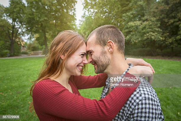 Young romantic couple, touching noses