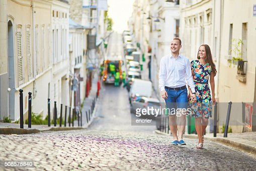 Young romantic couple walking on Montmartre : Stock Photo