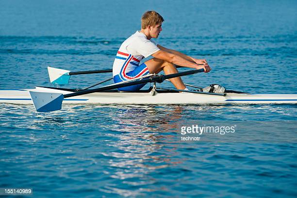 Young  rowing man in the action