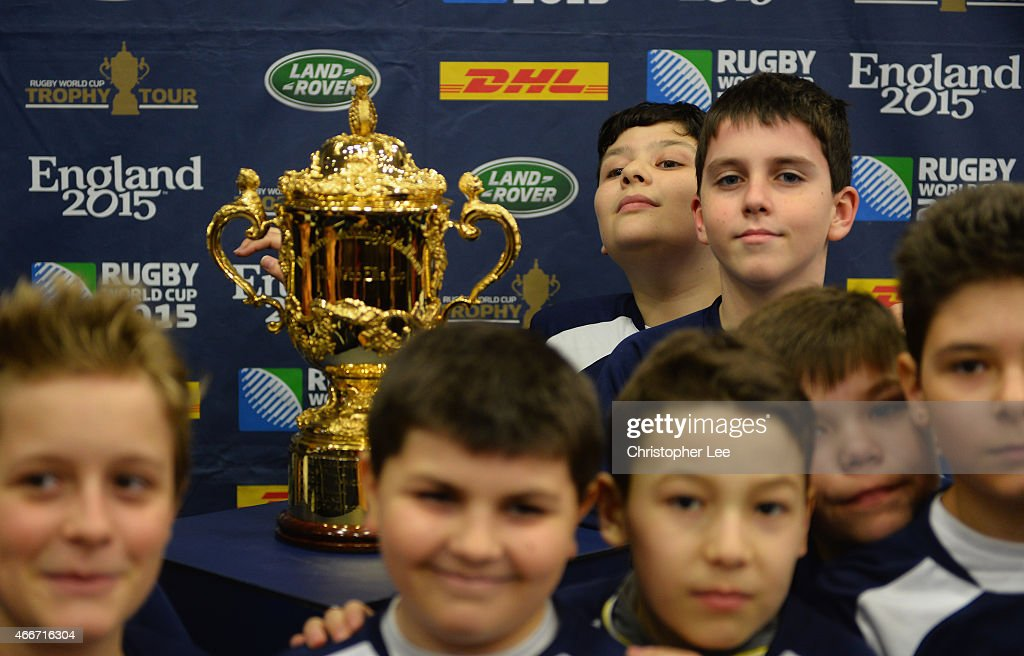 A young rugby fan has his photograph taken with the Webb Ellis Cup during the Rugby World Cup Trophy Tour in partnership with Land Rover and DHL ahead of Rugby World Cup 2015 on March 17, 2015 in Bucharest, Romania.