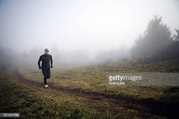 Young Runner Jogging in Morning Fog