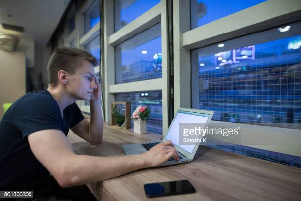Young Russian businessman working at night