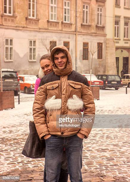 Young russian couple hugging eachother at street of lviv ukraine
