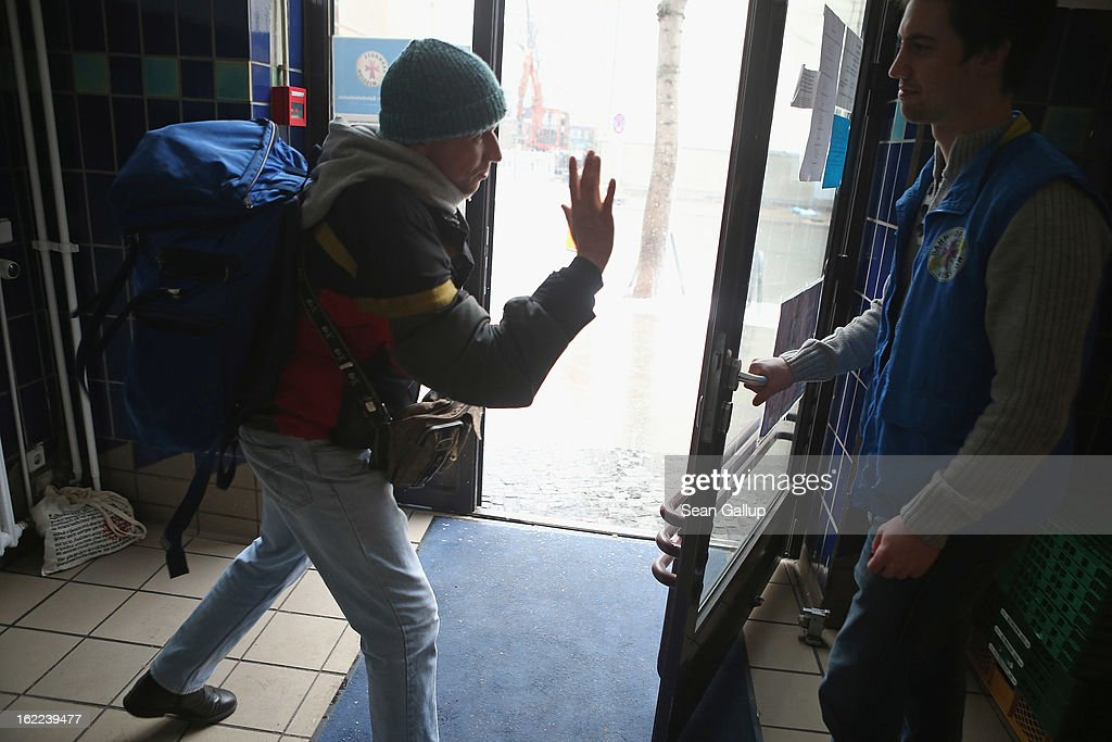 A young Russian homeless man bids farewell after receiving a free lunch at the Bahnhofsmission Protestant charity facility at Zoo train station on February 20, 2013 in Berlin, Germany. The Bahnhofsmission feeds up to 600 needy men and women every day, up from 400 only three years ago. Approximately 60% of the visitors are from Eastern Europe, many of them workers in low-paying jobs who became unemployed and ran out of money. Dieter Puhl, who runs the Bahnhofsmission, says he is seeing a steady increase in the number of visitors, especially among older Germans whose pensions are insufficient for them to make ends meet. Poverty in Germany, defined as someone who makes less than 60% of the median wage, has risen steadily in recent years, and according to statistics 14% of people in Germany lived below the poverty line in 2010. Both poverty and pensions that have not kept up with the rising cost of living will be contested topics in federal elections scheduled later for this year.