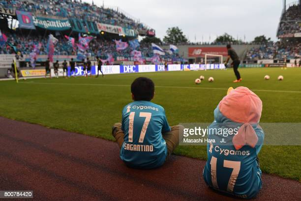 Young Sagan Tosu supporters watch players' warm up prior to the JLeague J1 match between Sagan Tosu and Urawa Red Diamonds at Best Amenity Stadium on...