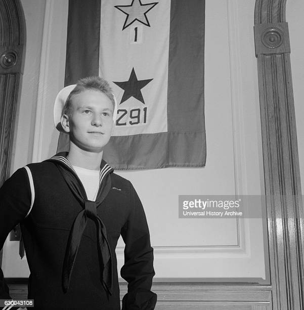 Young Sailor who Graduated High School in June Standing in front of School's Service Flag Washington DC USA Esther Bubley for Office of War...
