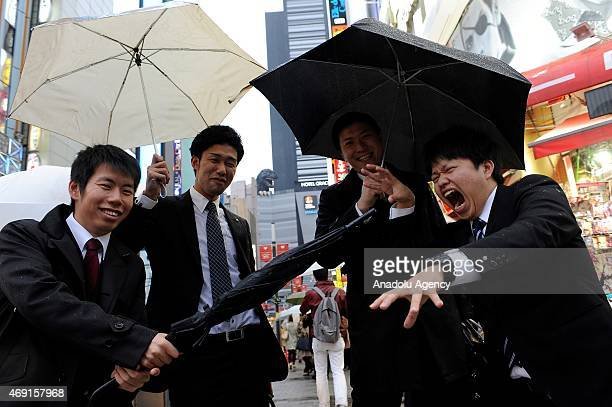 Young salarymen are playing on the Kabukicho street while a 12 meters tall Godzilla replica based on the original 1954 film is seen on the top of the...