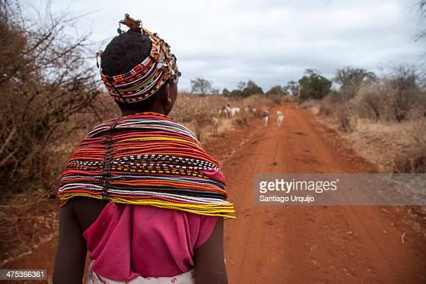 Young Samburu shepherdess traditionally dressed