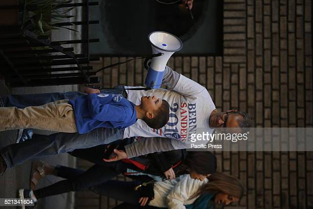 Young Sanders supporter uses bullhorn to exhort waiting supporters Thousands of Bernie Sanders supporters descended onto Washington Square Park for a...