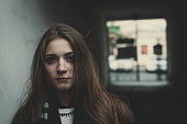 Young pensive long haired sacred girl standing outside alone
