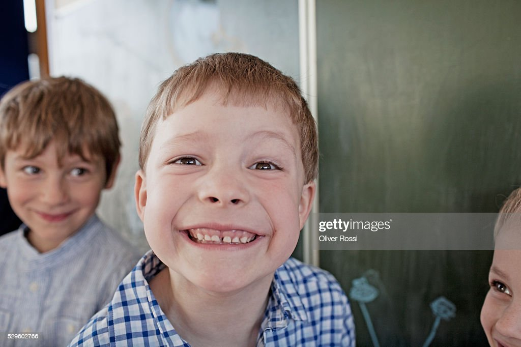 Young school boy (6-7) grinning : Stock Photo